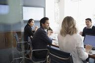 Business people talking, using laptop in conference room meeting - HEROF21931
