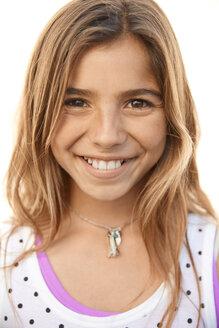 Close up portrait smiling Latina girl - HEROF21985