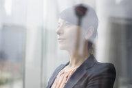 Pensive businesswoman looking away - HEROF22390
