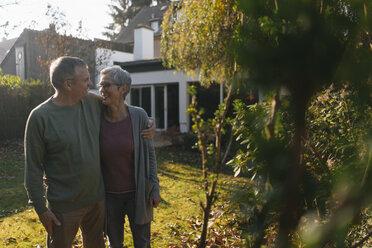 Affectionate senior couple embracing in garden - KNSF05555