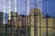 Germany, Berlin, Berlin-Mitte, reflection of the Reichstag building in a glass faceade - ALEF00096