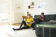 Casual couple relaxing in living room at home - SBOF01790