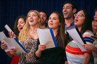 Multi-ethnic friends singing at choir practice in language school - MASF11230