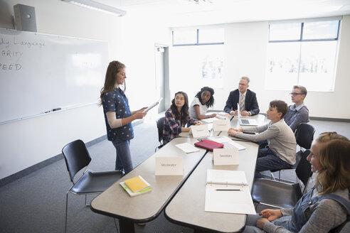 Girl middle school student speaking in debate club classroom - HEROF22805