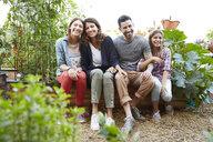 Portrait smiling Latina family in vegetable garden - HEROF23030