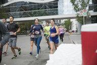 Marathon runners running on urban street - HEROF23102