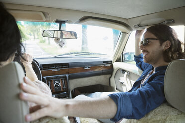 Smiling man with sunglasses riding in passenger seat of car - HEROF23246