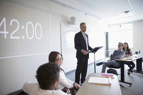 Teacher leading debate club lesson in classroom - HEROF23354