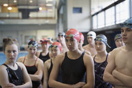 Attentive swimmers standing and listening in swimming practice - HEROF23489
