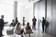 Business people brainstorming in conference room meeting - HEROF23516