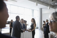 Business people talking, networking at conference - HEROF23537