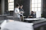 Creative business people meeting, using laptop in office - HEROF23972