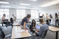 College students studying in group in classroom - HEROF24068