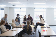College students talking in group in classroom - HEROF24071