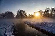 Germany, Landshut, foggy landscape in winter at sunrise - SARF04111