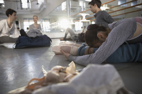 Ballet dancers stretching, warming up in dance studio - HEROF24122