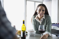 Portrait of smiling woman drinking red wine - HEROF24317