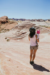 USA, Nevada, Valley of Fire State Park, back view of mother and baby girl watching landscape - GEMF02858