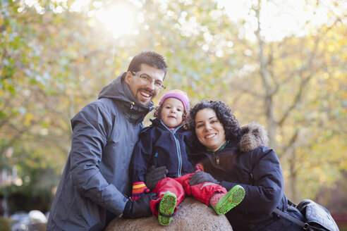 Portrait of happy family at park during winter - ASTF03879