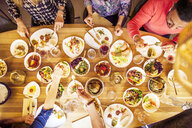 High angle view of male and female friends having meze at table in Lebanese restaurant - ASTF03921
