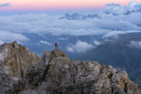 Italy, Veneto, Dolomites, Alta Via Bepi Zac, mountaineer standing on Pale di San Martino mountain at sunset - LOMF00825