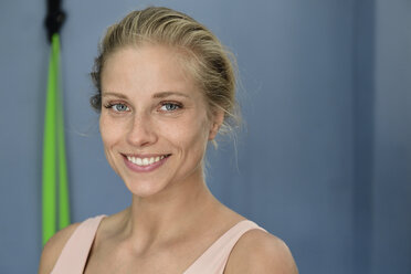 Portrait of smiling young blond woman in a gym - ECPF00526