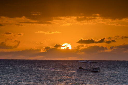 Jamaica, Negril, Seven mile beach, little fishing boat at sunset - RUNF01313