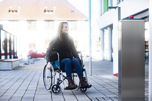 Young woman in wheelchair in the city - SGF02255