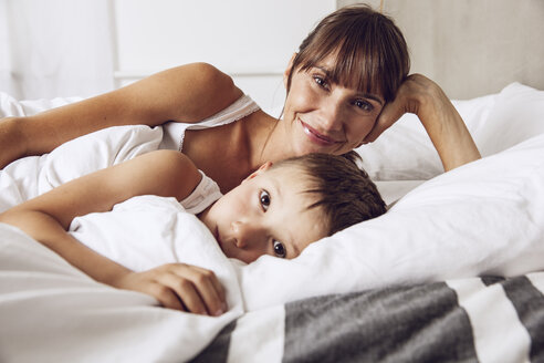 Mother and son cuddling in bed - MCF00044