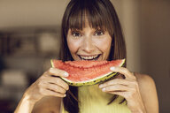 Beautiful woman eating slice of watermelon - MCF00068