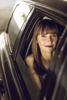 Beautiful woman sitting in car - MCF00095