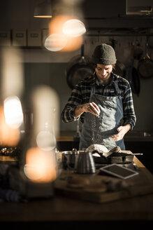 Man preparing bread dough in his kitchen - MJRF00013