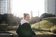Portrait of smiling young woman in the city - JRFF02680