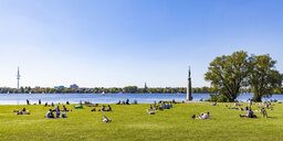 Germany, Hamburg, Alster Lake, people relaxing on lawn - WD05129