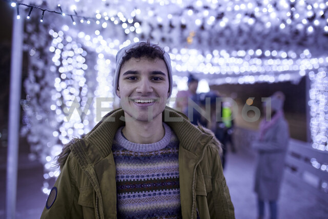 Portrait of smiling young man in winter decoration - ZEDF01908 - Zeljko Dangubic/Westend61