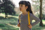 Portrait of little girl with backpack in nature - ERRF00782