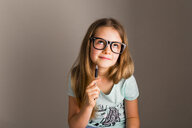 Portrait of smart girl with oversized glasses thinking - NMS00288