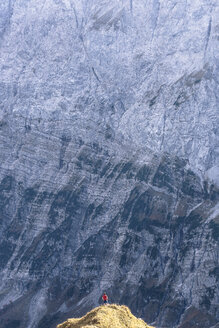 Austria, Tyrol, Hinterriss, man standing on an edge in the Karwendel mountains between Torkopf and Gamskar - WFF00030
