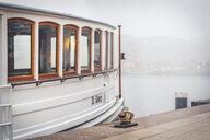 Germany, Hamburg, tourboat at Jungfernstieg in fog - KEB01177