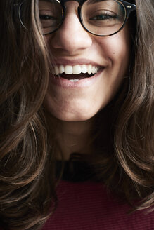 Portrait of laughing young woman wearing glasses - IGGF00812