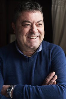 Portrait of smiling senior man wearing blue pullover - IGGF00815