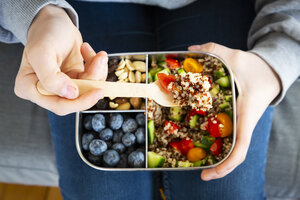 Lunchbox with quinoa salad with tomato and cucumber, blue berry and trail mix - LVF07831