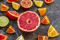 Sliced citrus fruits on slate - SARF04125