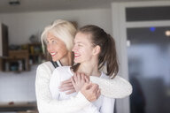 Happy mother and daughter together at home - SGF02295