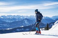 Germany, Bavaria, Brauneck, man on a ski tour in winter in the mountains - DIGF05947