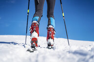 Legs of a man on a ski tour in winter in the mountains - DIGF05953