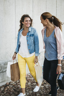 Two happy friends with shopping bags - HMEF00258
