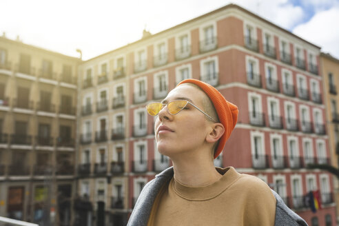 Spain, Madrid, thoughtful portrait of a young woman in the city - WPEF01367