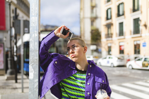 Spain, Madrid, thoughtful portrait of a young woman in the city - WPEF01373