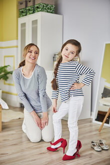 Mother and daughter dressing up, wearing matching clothes - ABIF01176